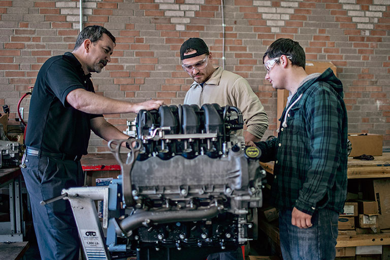 Students working on an truck engine
