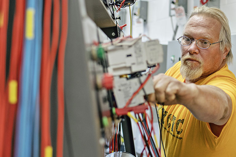 Man constructing an electrical system